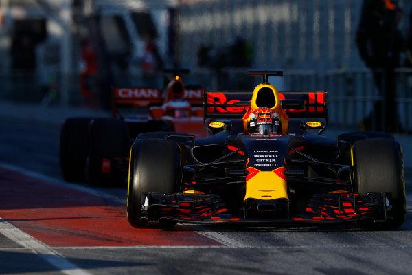 Circuit de Barcelona Catalunya, Barcelona, Spain. Thursday 02 March 2017. Max Verstappen, Red Bull Racing RB13 TAG Heuer, exits the pit lane ahead of Stoffel Vandoorne, McLaren MCL32 Honda.  World Copyright: Steven Tee/LAT Images ref: Digital Image _R3I7291
