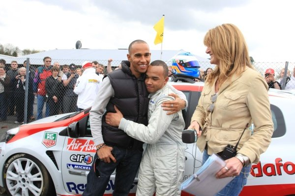 Nicolas Hamilton (GBR), Total Control Racing, centre, with brother Lewis Hamilton (GBR), McLaren, left, and Louise Goodman (GBR), ITV presenter. Renault Clio Cup, Rd1, Brands Hatch, England, 3 April 2011.