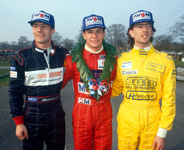 Oulton Park,, England. 29th March 1991. Rd 1.Paul Warwick (Reynard 90D Cosworth Langford-Peck), 1st position with Julian Westwood (Lola T90/50-Cosworth), 2nd position and Gimax Jr. (Reynard 90D-Cosworth), 3rd position, podium, portrait. action. World Copyright: LAT Photographic.Ref:  Colour Transparency.