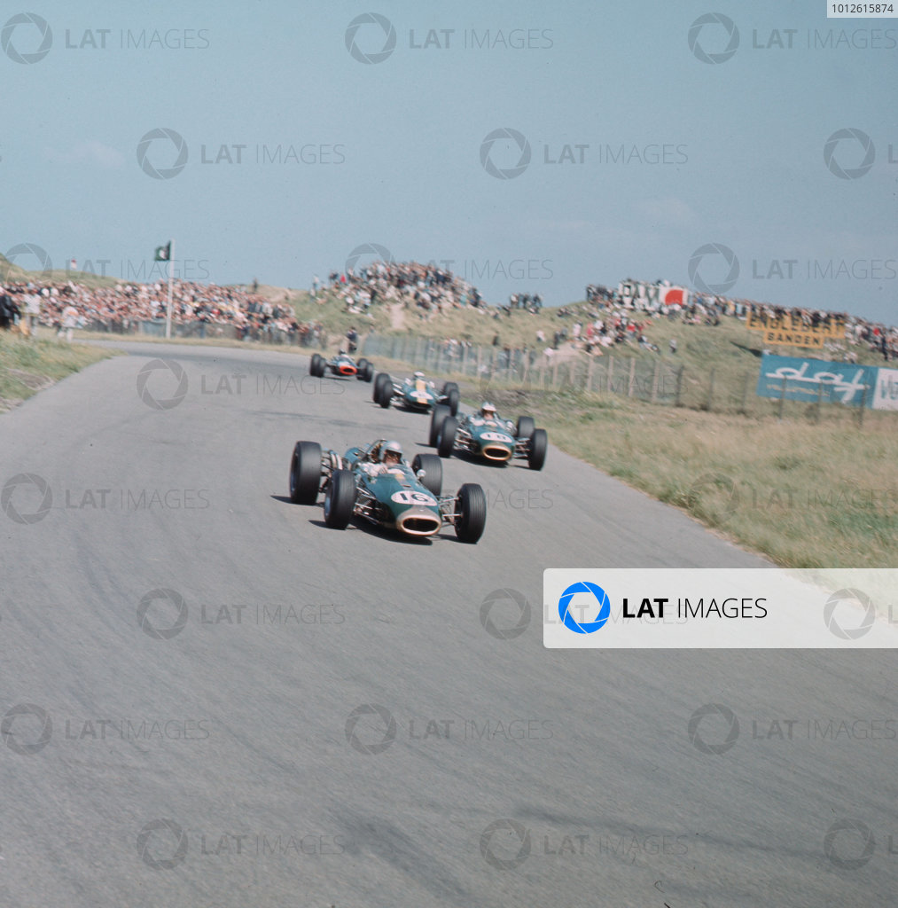 Zandvoort, Holland.22-24 July 1966.Jack Brabham (Brabham BT19 Repco) leads Denny Hulme (Brabham BT20 Repco) and Jim Clark (Lotus 33 Climax). Brabham and Clark finished in 1st and 3rd positions respectively.Ref-3/2302.World Copyright - LAT Photographic