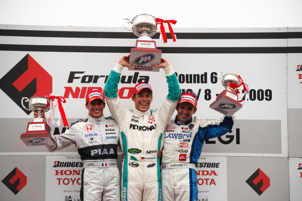 Motegi, Japan. 8th - 9th August 2009.Rd6  - Winner Andre Lotterer ( #36 PETRONAS TEAM TOM'S ), podium, portrait.World Copyright: Yasushi Ishihara/LAT Photographicref: Digital Image 2009FN_Rd6_010