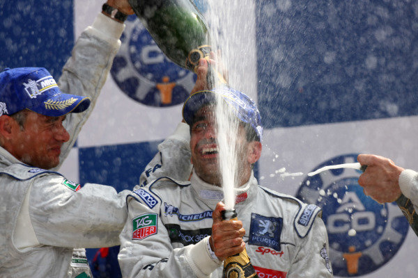 Circuit de La Sarthe, Le Mans, France.8th - 14th June 2009. Stephane Sarrazin, No 8 Peugeot 908 HDi, 2nd overall, and Marc Gene, No 9 Peugeot 908 HDi, 1st overall, spray the champagne on the podium. Portrait. Podium. World Copyright: Kevin Wood/LAT Photographic Photographic Ref: IMG_7134 JPG