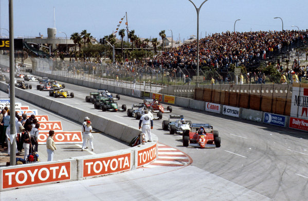 Long Beach, California, USA. 25-27 March 1983.Patrick Tambay (Ferrari 126C2B) leads Keke Rosberg and Jacques Laffite (both Williams FW08C's) into Queens Hairpin at the start. Ref-83 LB 05.World Copyright - LAT Photographic