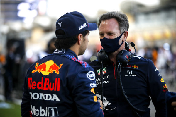 Christian Horner, Team Principal, Red Bull Racing and Sergio Perez, Red Bull Racing on the grid