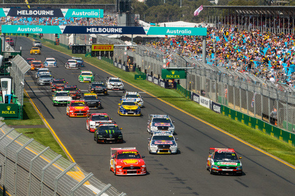 Scott McLaughlin, DJR Team Penske, Ford, leads Chaz Mostert, Tickford Racing, Ford, Jamie Whincup, Triple Eight Racing Engineering, Holden, Lee Holdsworth, Tickford Racing, Ford, Shane van Gisbergen, Triple Eight Racing Engineering, Holden, and the rest of the field at the start