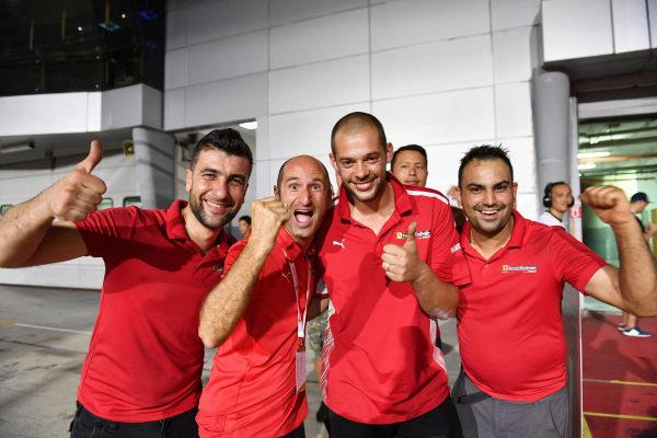 Ferrari Challenge Clienti team members celebrate in parc ferme