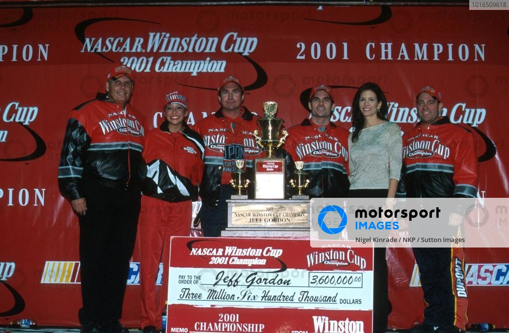 Jeff Gordon (USA) celebrates his fourth Winston Cup title with the rest of his team.
