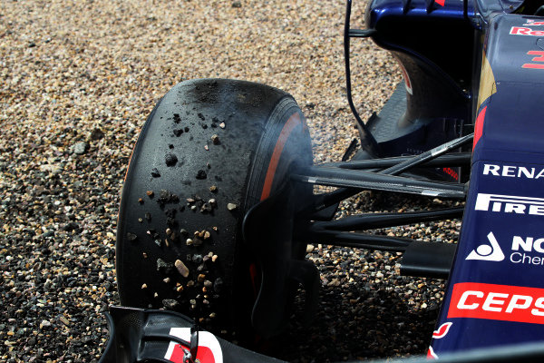 The front tyre Max Verstappen (NED) Scuderia Toro Rosso STR10 crashed into the gravel at Formula One World Championship, Rd9, British Grand Prix, Race, Silverstone, England, Sunday 5 July 2015.
