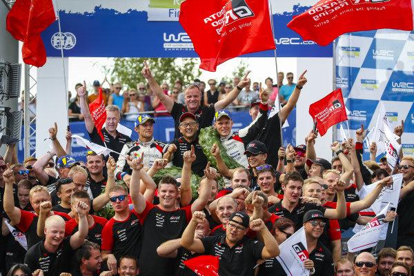 The Toyota WRC team celebrate winning Rally Finland