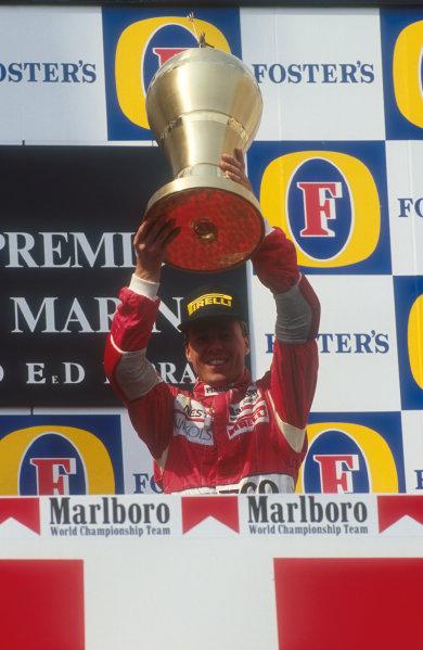 1991 San Marino Grand Prix.Imola, Italy.26-28 April 1991.J J. Lehto (Dallara Judd) celebrates 3rd position on the podium.Ref-91 SM 13.World Copyright - LAT Photographic