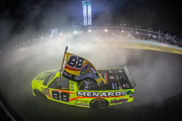 NASCAR Camping World Truck Series 2014 champion Matt Crafton celebrates