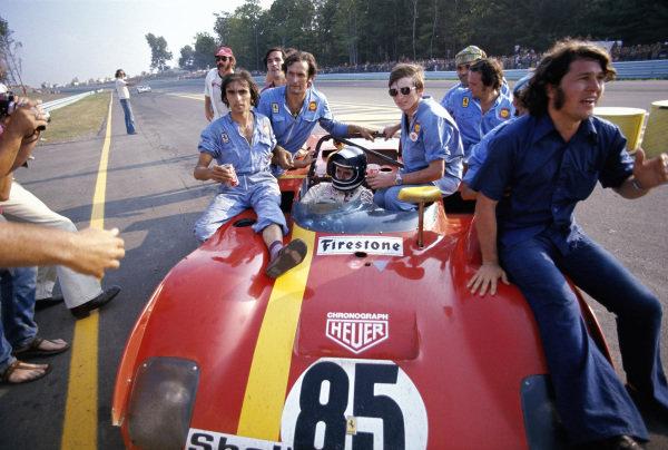 Jacky Ickx in his winning SEFAC Ferrari, Ferrari 312PB ferries his mechanics towards the podium.