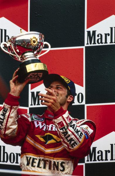 Jacques Villeneuve, 3rd position, celebrates on the podium.