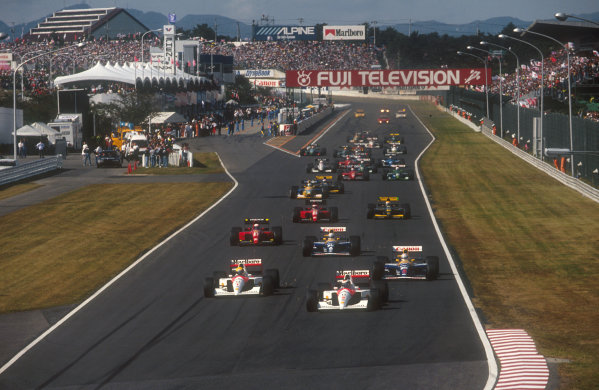 1991 Japanese Grand Prix.Suzuka, Japan.18-20 October 1991.Poleman Gerhard Berger leads teammate Ayrton Senna (both McLaren MP4/6 Honda's), Nigel Mansell, Riccardo Patrese (both Williams FW14 Renault's), Alain Prost, Jean Alesi (both Ferrari 643's), Pierluigi Martini (Minardi M191 Ferrari), Michael Schumacher (Benetton B191 Ford) and Gianni Morbidelli (Minardi M191 Ferrari) at the start.Ref-91 JAP 02.World Copyright - LAT Photographic