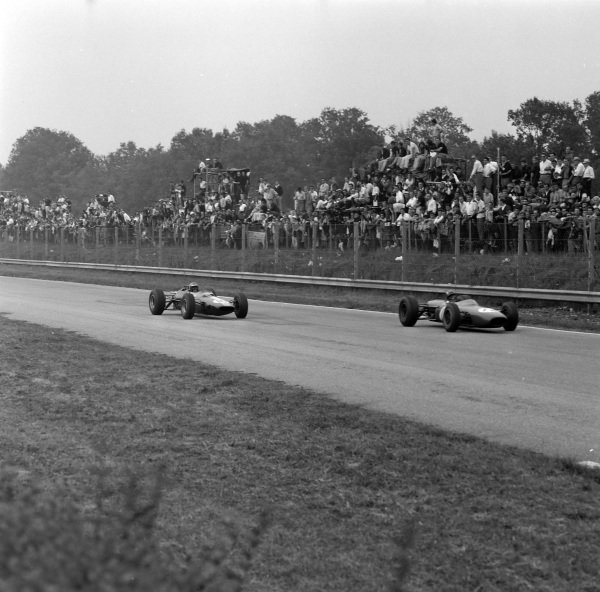 Jo Siffert, Brabham BT11 BRM, leads Mike Spence, Lotus 33 Climax.