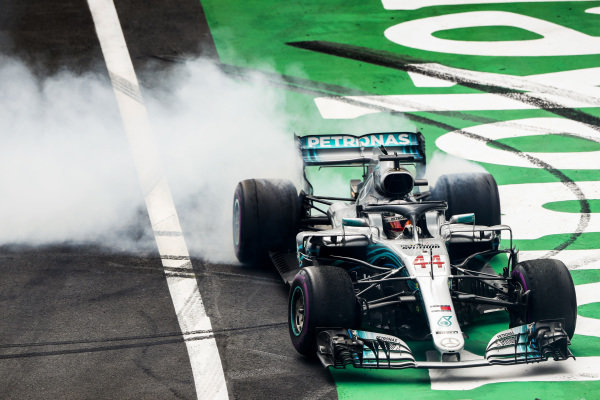 Lewis Hamilton, Mercedes AMG F1 W09 EQ Power+, performs donuts in celebration of securing his fifth world drivers championship title