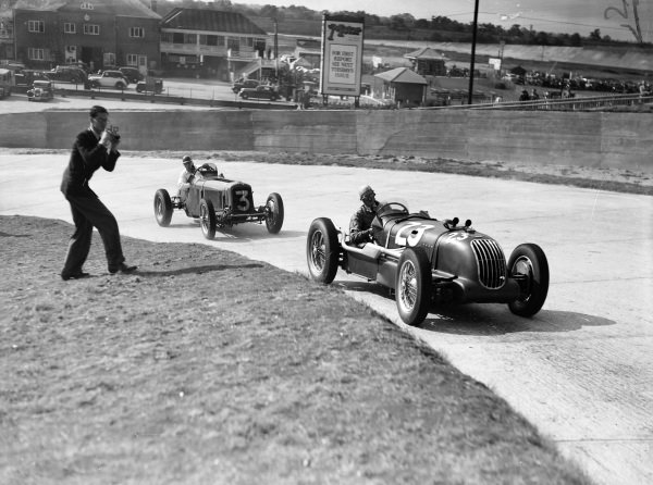 N. G. Wilson, ERA, follows another car through the corner.