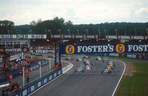 1993 British Grand Prix.Silverstone, England.9-11 July 1993.Alain Prost leads Damon Hill (both Williams FW15C Renault's), Ayrton Senna (McLaren MP4/8 Ford), Michael Schumacher, Riccardo Patrese (both Benetton B193B Ford's), Martin Brundle (Ligier JS39 Renault) and Johnny Herbert (Lotus 107B Ford) from the grid at the start. Ref-93 GB 10.World Copyright - LAT Photographic