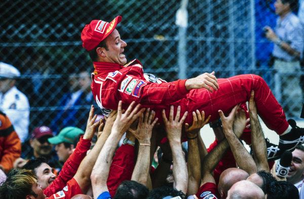 Rubens Barrichello celebrates 2nd position with the Ferrari team.