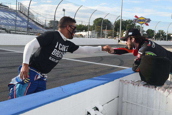 """Darrell Wallace Jr., Richard Petty Motorsports Chevrolet, wears a """"I Can't Breathe - Black Lives Matter"""" t-shirt under his firesuit in solidarity with protesters around the world taking to the streets after the death of George Floyd on May 25, and Daniel Suarez, Gaunt Brothers Racing CommScope, Copyright: Jared C. Tilton/Getty Images."""