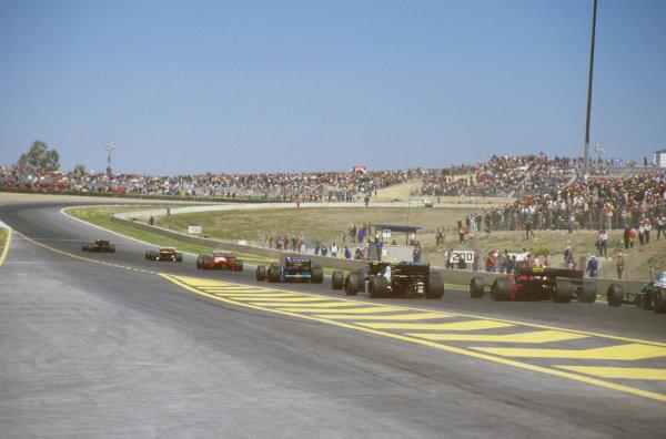 Jerez, Spain.11-13 April 1986.Ayrton Senna (Lotus 98T Renault) leads Nelson Piquet, Nigel Mansell (both Williams FW11 Honda's) and Alain Prost (McLaren MP4/2C TAG Porsche) on the parade lap.Ref-86 ESP 28.World Copyright - LAT Photographic
