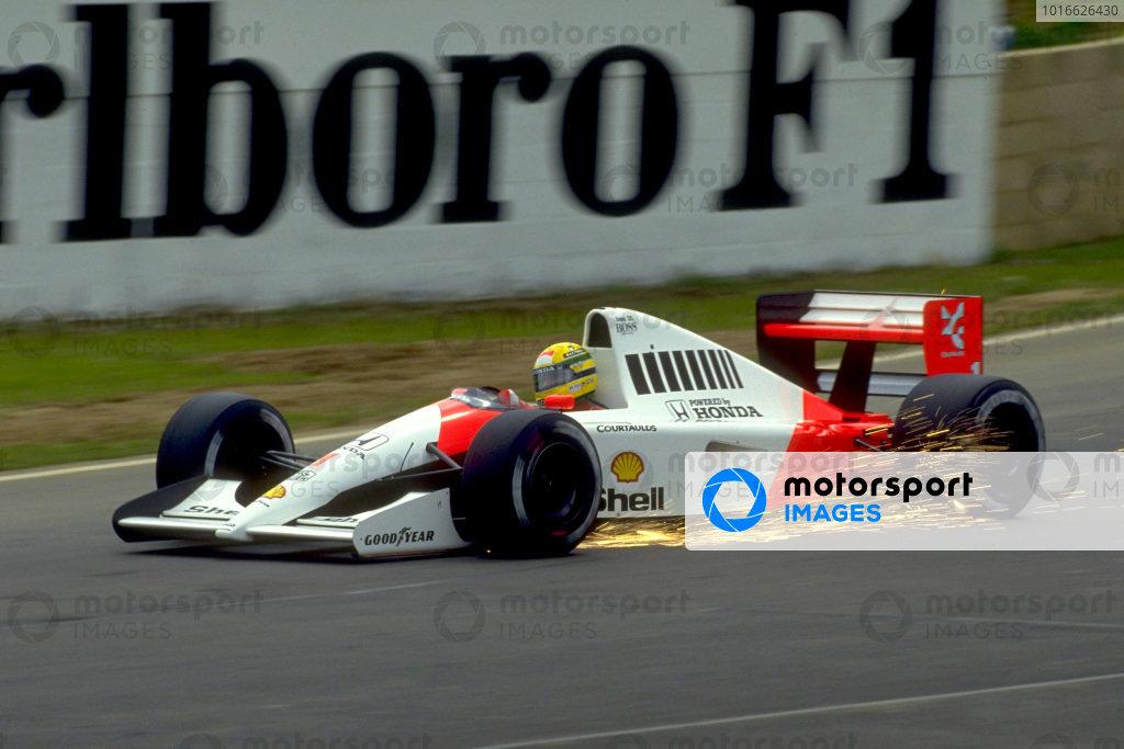 Ayrton Senna, McLaren MP4-6 Honda, with sparks flying at Bridge corner.