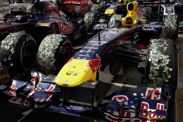 Sebastian Vettel's Red Bull RB7 Renault covered in confetti in Parc Ferme.
