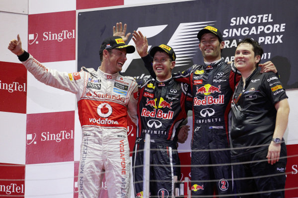 Sebastian Vettel, 1st position, celebrates on the podium with Jenson Button, 2nd position, and Mark Webber, 3rd position, and Tim Malyon.