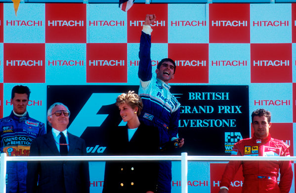 1994 British Grand Prix.Silverstone, England.8-10 July 1994.Damon Hill (Williams Renault) 1st position, Michael Schumacher (Benetton Ford) 2nd position, but later disqualified for overtaking on the parade lap and Jean Alesi (Ferrari) now 2nd position on the podium. HRH the Princess of Wales stands in front.Ref-94 GB 13.World Copyright - LAT Photographic