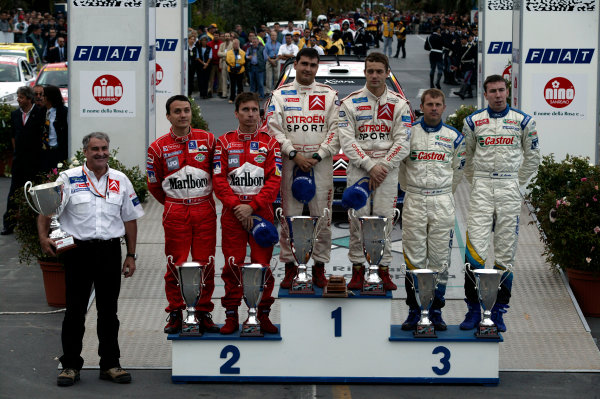 2003 FIA World Rally Champs. Round Eleven Sanremo Rally 2nd-5th October 2003.Sebastien Loeb, Citroen, podium. World Copyright: McKlein/LAT