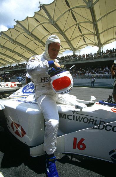Sepang, Kuala Lumpur, Malaysia. 15-17 October 1999. Rubens Barrichello (Stewart SF-3 Ford). Portrait, helmet. Ref: 99MAL20. World Copyright - LAT Photographic