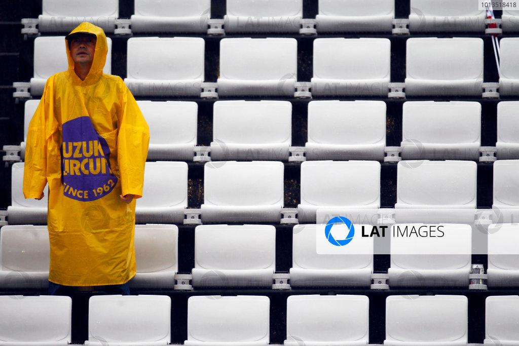 Suzuka Circuit, Suzuka, Japan.9th October 2010.A die-hard fan tries to enjoy the action. Atmosphere. World Copyright:Steven Tee/LAT Photographicref: Digital Image _A8C1319