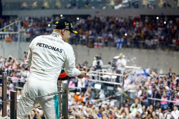 Yas Marina Circuit, Abu Dhabi, United Arab Emirates. Sunday 26 November 2017. Valtteri Bottas, Mercedes AMG, celebrates his win on the podium. World Copyright: Steven Tee/LAT Images  ref: Digital Image _O3I3475