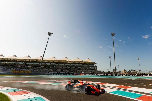 Yas Marina Circuit, Abu Dhabi, United Arab Emirates. Friday 24 November 2017. Stoffel Vandoorne, McLaren MCL32 Honda, locks a brake. World Copyright: Glenn Dunbar/LAT Images  ref: Digital Image _X4I6538