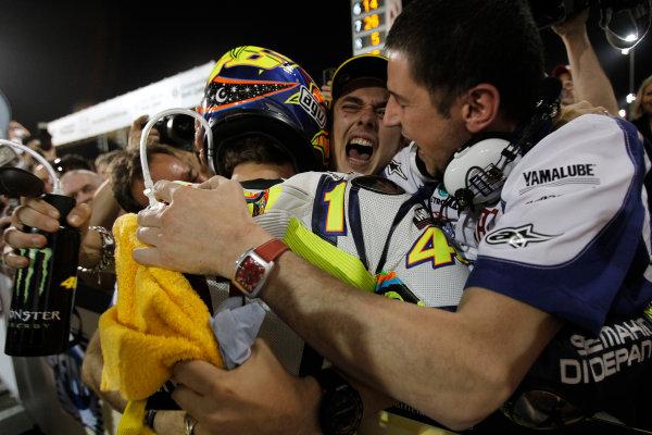 Losail International Circuit, Qatar.Round 1. 9th - 11th April 2010.An emotional Uccio greets Rossi in parc ferme.World Copyright: Martin Heath/LAT Photographicref: Digital Image _J1C9779