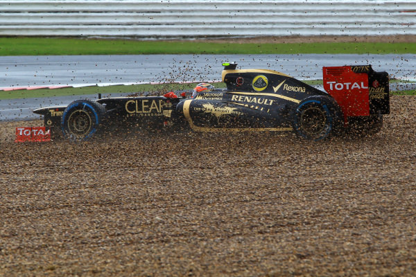 Romain Grosjean (FRA) Lotus E20 spins into the gravel. Formula One World Championship, Rd9, British Grand Prix, Qualifying, Silverstone, England, Saturday 7 July 2012. BEST IMAGE