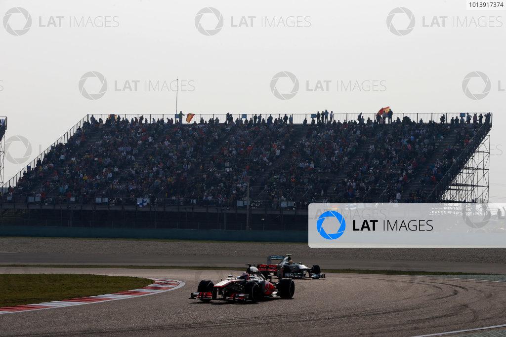 Shanghai International Circuit, Shanghai, China Sunday 14th April 2013 Jenson Button, McLaren MP4-28 Mercedes, leads Lewis Hamilton, Mercedes W04.  World Copyright: Glenn Dunbar/LAT Photographic ref: Digital Image _89P8523