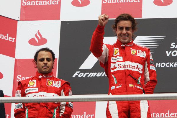 Race winner Fernando Alonso (ESP) Ferrari (Right) celebrates on the podium alongside second placed team mate Felipe Massa (BRA) Ferrari. Formula One World Championship, Rd 11, German Grand Prix, Race, Hockenheim, Germany, Sunday 25 July 2010.  BEST IMAGE