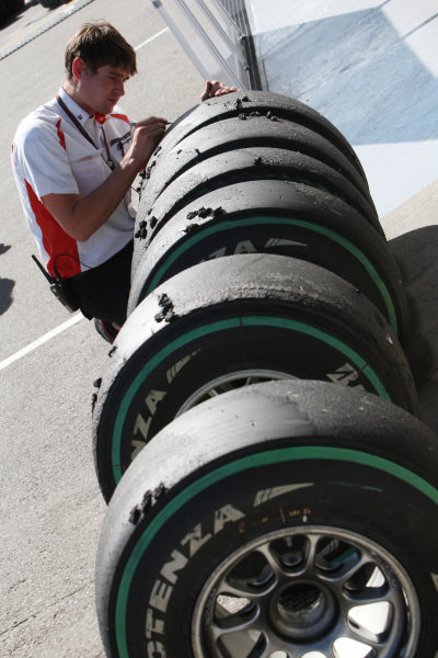 Bridgestone tyre engineer.  Formula One World Championship, Rd 10, British Grand Prix, Practice Day, Silverstone, England, Friday 9 July 2010.