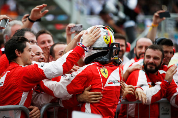 Interlagos, Sao Paulo, Brazil. Sunday 15 November 2015. Sebastian Vettel, Ferrari, 3rd Position, and the Ferrari team celebrate in Parc Ferme. World Copyright: Steven Tee/LAT Photographic. ref: Digital Image _L4R4225
