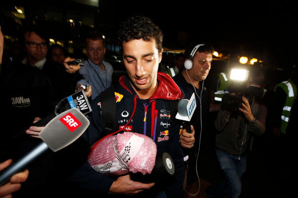 Albert Park, Melbourne, Australia. Sunday 16 March 2014. Daniel Ricciardo, Red Bull Racing, is interviewed regarding the stewards decision to remove his 2nd Placed finish. World Copyright: Charles Coates/LAT Photographic. ref: Digital Image _J5R6471