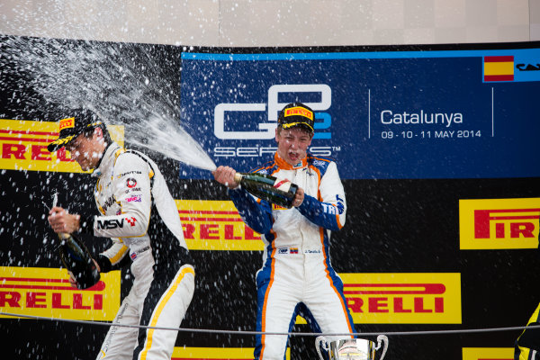 2014 GP2 Series Round 2 - Race 1. Circuit de Catalunya, Barcelona, Spain. Saturday 10 May 2014. Johnny Cecotto (VEN, Trident) & Jolyon Palmer (GBR, DAMS) spray champagne Photo: Malcolm Griffiths/GP2 Series Media Service. ref: Digital Image A50A3186