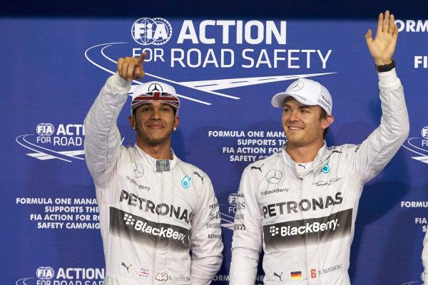 Yas Marina Circuit, Abu Dhabi, United Arab Emirates. Saturday 22 November 2014. Front row starters, pole man Nico Rosberg, Mercedes AMG, and Lewis Hamilton, Mercedes AMG. World Copyright: Steve Etherington/LAT Photographic. ref: Digital Image SNE12325