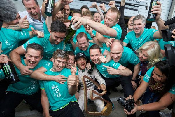 Red Bull Ring, Spielberg, Austria. Sunday 21 June 2015. Nico Rosberg, Mercedes AMG, 1st Position, celebrates with his team. World Copyright: Steve Etherington/LAT Photographic. ref: Digital Image SNE25030