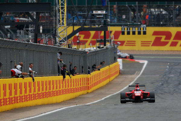 2015 GP3 Series Round 3. Silverstone, Northamptonshire, England. Sunday 5 July 2015. Kevin Ceccon (ITA, Arden International) takes the chequered flag. Photo: Zak Mauger/GP3 Series Media Service. ref: Digital Image _L0U5267