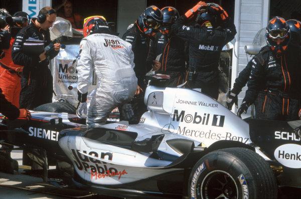 2005 Hungarian Grand Prix. Hungaroring, Hungary. 29th - 31st July 2005 Juan Pablo Montoya, McLaren Mercedes MP4-20 retires from the race. Action. World Copyright: Steven Tee/LAT Photographi--c Ref: 35mm Image A09