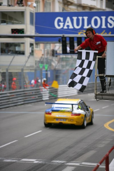 2006 Monaco Grand Prix - Porsche SupercupMonte Carlo, Monaco. 23rd - 28th May.Richard Lietz crosses the line and takes the chequered flag to win the race. Action.World Copyright: Lorenzo Bellanca/LAT Photographicref: Digital Image ZD2J1204