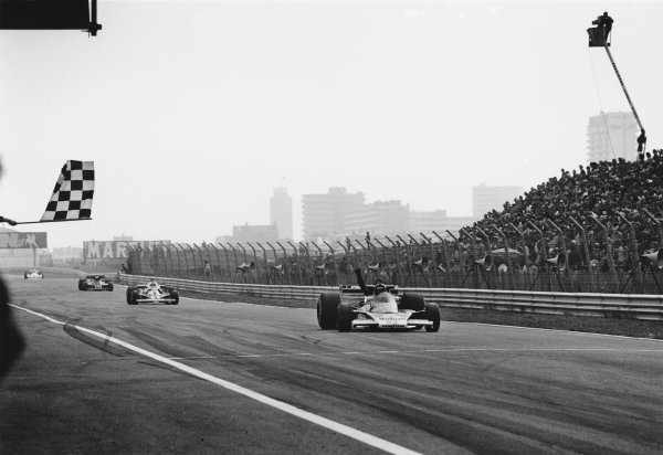 Zandvoort, Holland. 27th - 29th August 1976. James Hunt (McLaren M23-Ford), 1st position, crosses the finish line just infront of Clay Regazzoni (Ferrari 312T2), 2nd position and Mario Andretti (Lotus 77-Ford), 3rd position, action.  World Copyright: LAT Photographic.  Ref:  9055 - 13-13A.