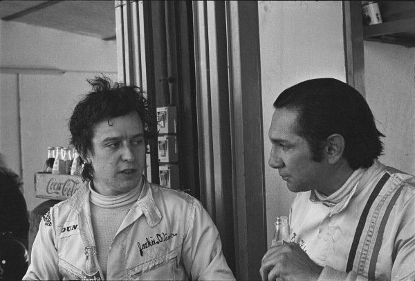 1970 Spanish Grand Prix. Jarama, Madrid, Spain. 17th - 19th April 1970. Jackie Oliver and Pedro Rodriguez (B.R.M. P153), in conversation in the pits, portrait.  World Copyright: LAT Photographic. Ref:  2996 - 39.