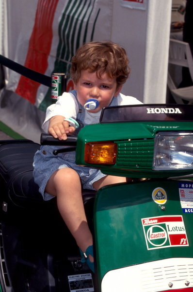 Joshua Hill (GBR) son of 1992 World Champion Damon Hill tries the Lotus scooter.